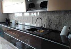 Как производят стеклянные фартуки для кухни?